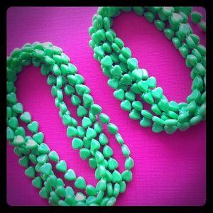 2 plastic heart vintage necklaces